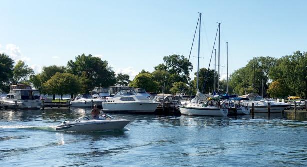 Powerboat motoring into Seneca Lake State Park Marina